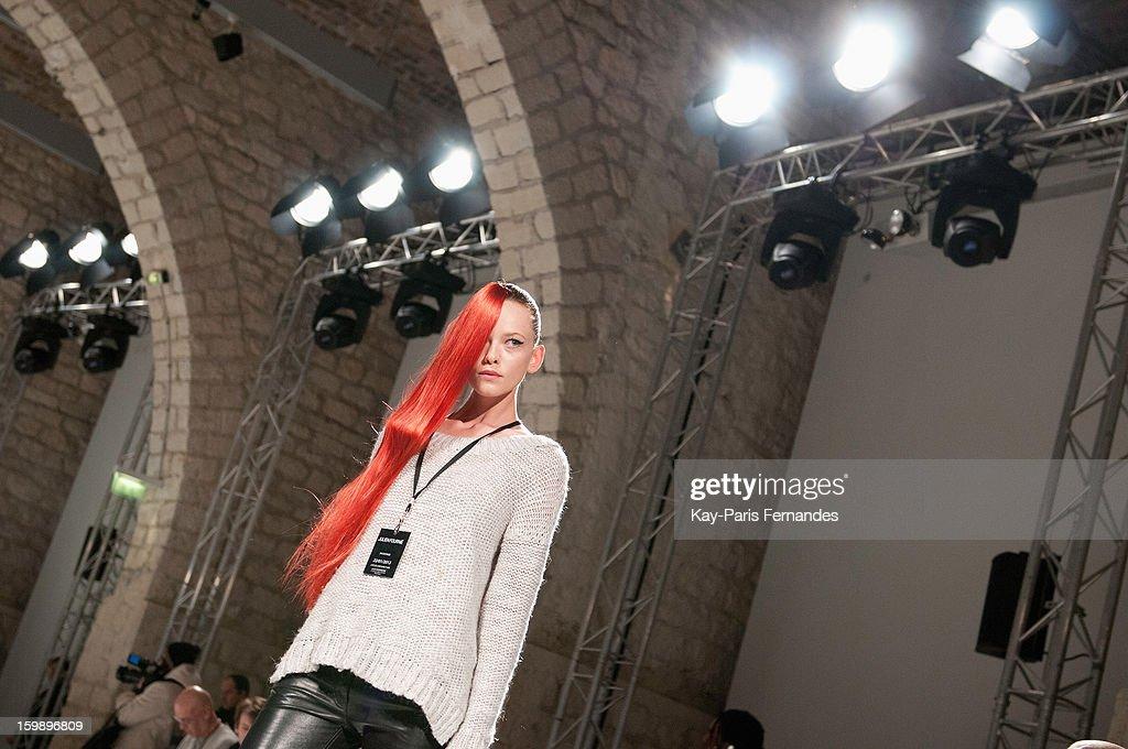 A model poses for photographers backstage before the Julien Fournie Spring/Summer 2013 Haute-Couture show as part of Paris Fashion Week at Cite de l'Architecture et du Patrimoine on January 22, 2013 in Paris, France.