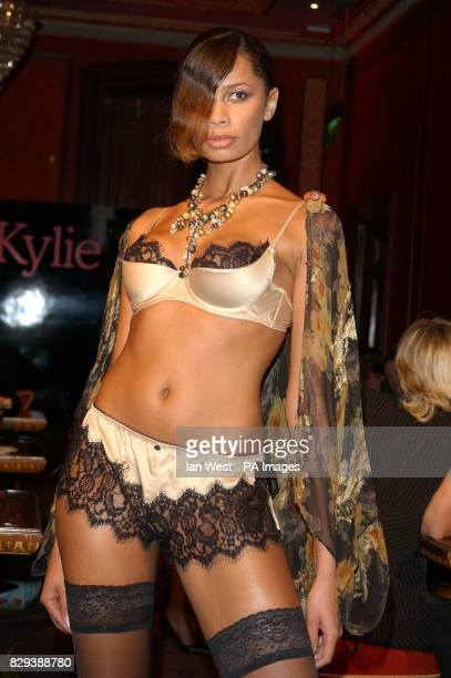 A model poses for photographers on the catwalk during the launch of Kylie Minogue's new Spring/Summer 2005 Love Kylie collection and the...