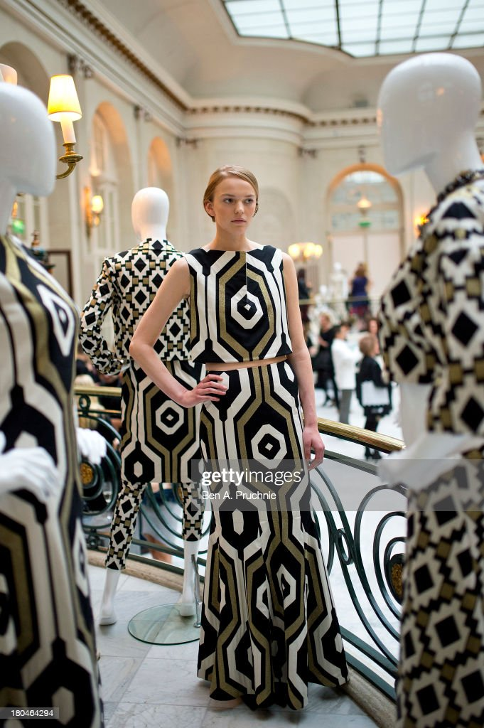 A model poses for photographs during the Kilian Kerner presentation at London Fashion Week SS14 at The Waldorf Hilton Hotel on September 13, 2013 in London, England.