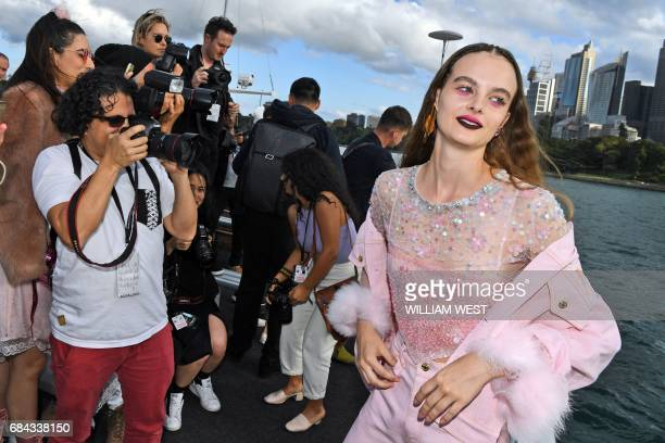 A model poses for photos after a parade by fashion label Dyspnea during Fashion Week Australia in Sydney on May 18 2017 / AFP PHOTO / William WEST