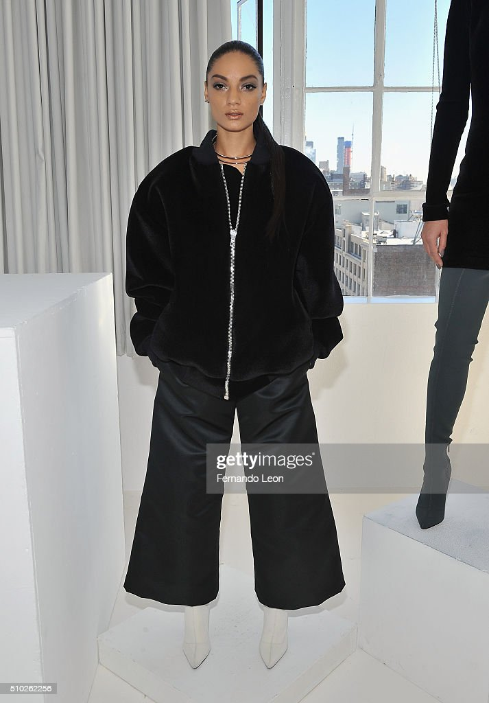 A model poses for pictures at the Laquan Smith Presentation at Jack Studios during Fall 2016 New York Fashion Week on February 14, 2016 in New York City.
