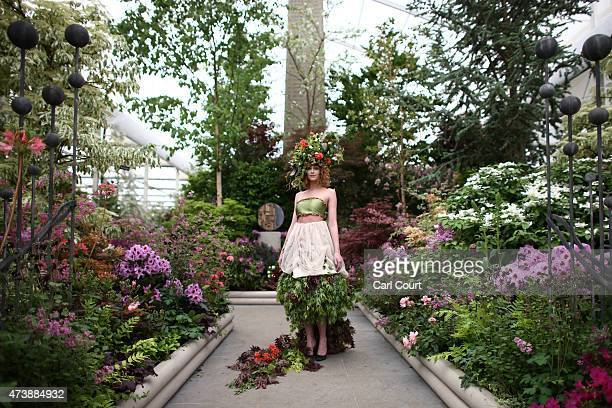 A model poses in a floral outfit on the press preview day of the Chelsea Flower Show on May 18 2015 in London England The show which has run annually...