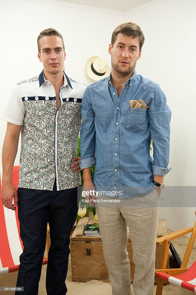 A model poses in clothing by Lorenz Bach next to Lorenz Bach during the Corner Presentation as part of the Paris Fashion Week Menswear Spring/Summer 2015 on June 28, 2014 in Paris, France.