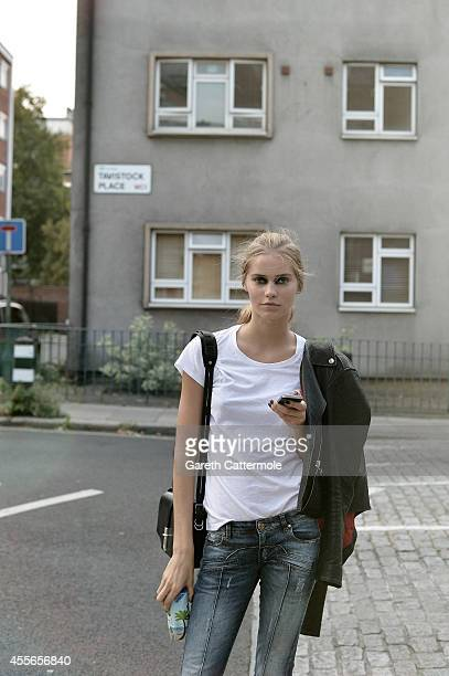 A model poses in the street after the GILES show during London Fashion Week Spring Summer 2015 on September 15 2014 in London England