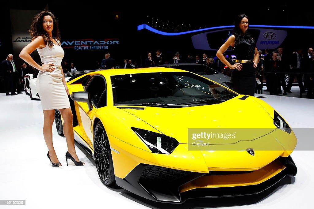 A model poses next to a lamborghini aventador during the 85th Geneva International Motor Show on March 3 2015 in Geneva Switzerland The International...