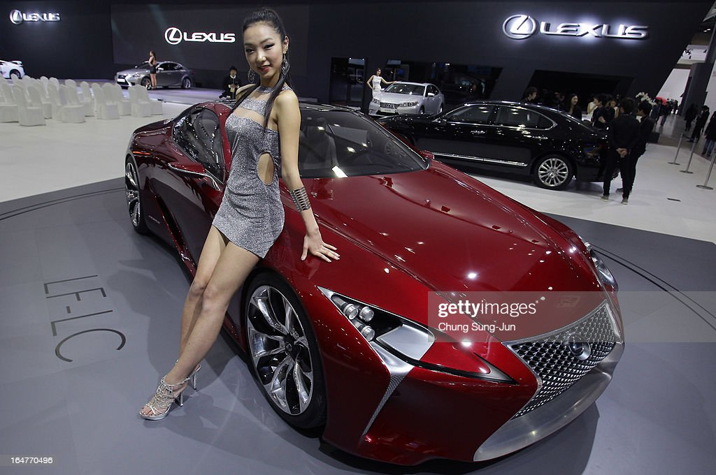 A Model poses next to a Lexus LF-LC Hybrid Sport Coupe Concept at the Seoul Motor Show 2013 on March 28, 2013 in Goyang, South Korea. The Seoul Motor Show 2013 will be held in March 29-April 7, featuring state-of-the-art technologies and concept cars from global automakers. The show is its ninth since the first one was held in 1995. About 384 companies from 14 countries, including auto parts manufacturers and tire makers, will set up booths to showcase trends in their respective industries, and to promote their latest products during the show.