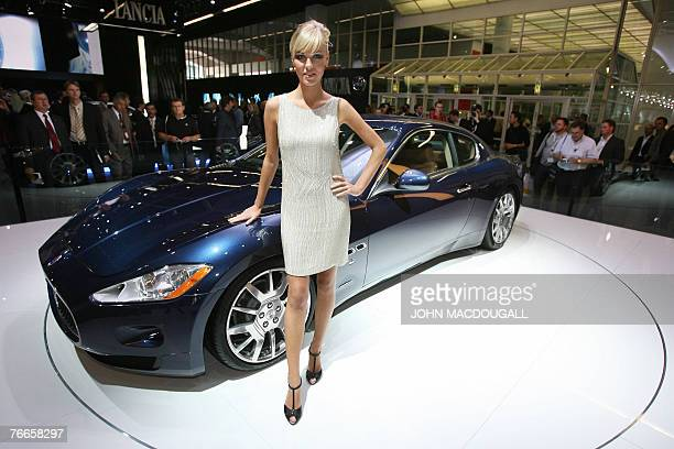 A model poses next to a Maserati Gran Turismo during the 62nd International Motor Show in Frankfurt 11 September 2007 The fair will be open for the...