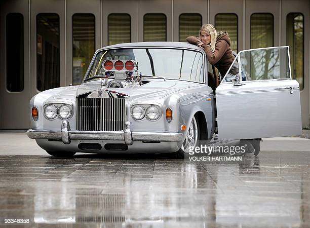 A model poses next to a Rolls Royce 'Silver Shadow' car with a tuned 1300horsepower engine which is according to its owner worth 700000 US dollars on...