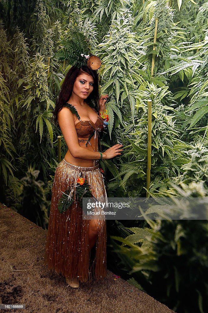 A model poses next to an exhibitor display at the Spannabis 2013 convention on hemp and marijuana products at the Feria de Cornella on February 16, 2013 in Barcelona, Spain.