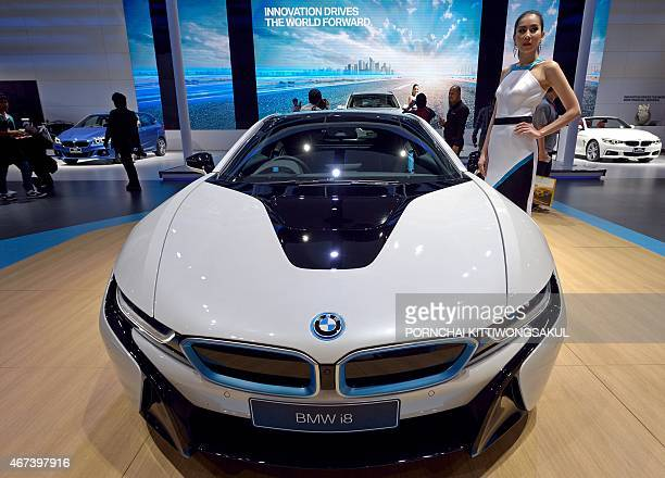 A model poses next to the new BMW i8 displayed at the 36th Bangkok International Motor Show on March 24 2015 The 36th Bangkok International Motor...