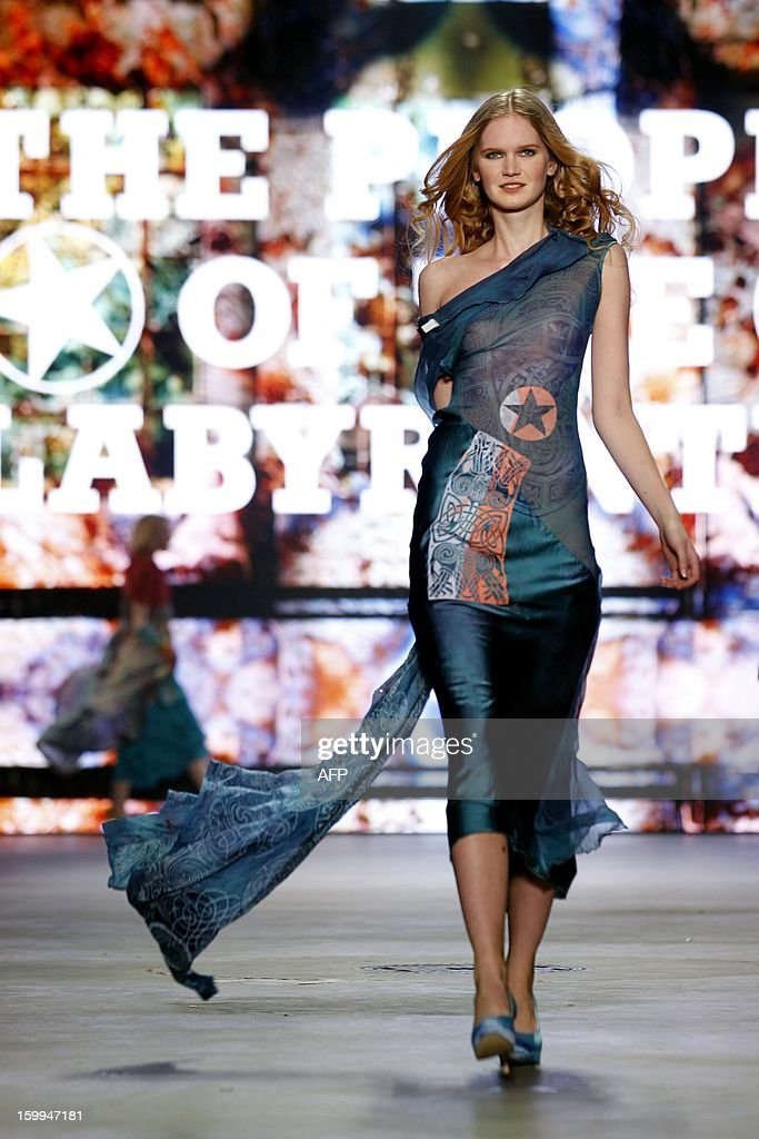 A model poses on the catwalk during the show of The People of the Labyrinths at the opening of the 18thAmsterdam Fashion Week in Amsterdam, The Netherlands, on January 23, 2013. The Fashion Week runs until January 27. netherlands out