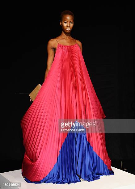 A model poses on the runway at the Czar By Cesar Galindo presentation during MercedesBenz Fashion Week Spring 2014 at The Box at Lincoln Center on...