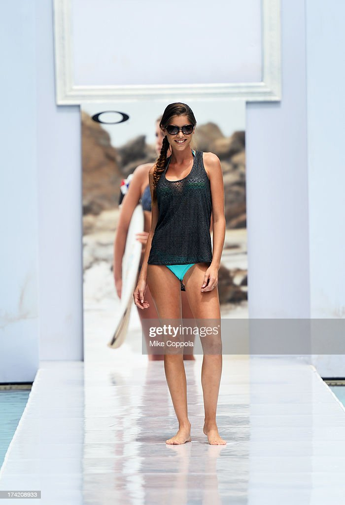 A model poses on the runway at the Oakley show during Mercedes-Benz Fashion Week Swim 2014 at the SLS Hotel on July 21, 2013 in Miami, Florida.