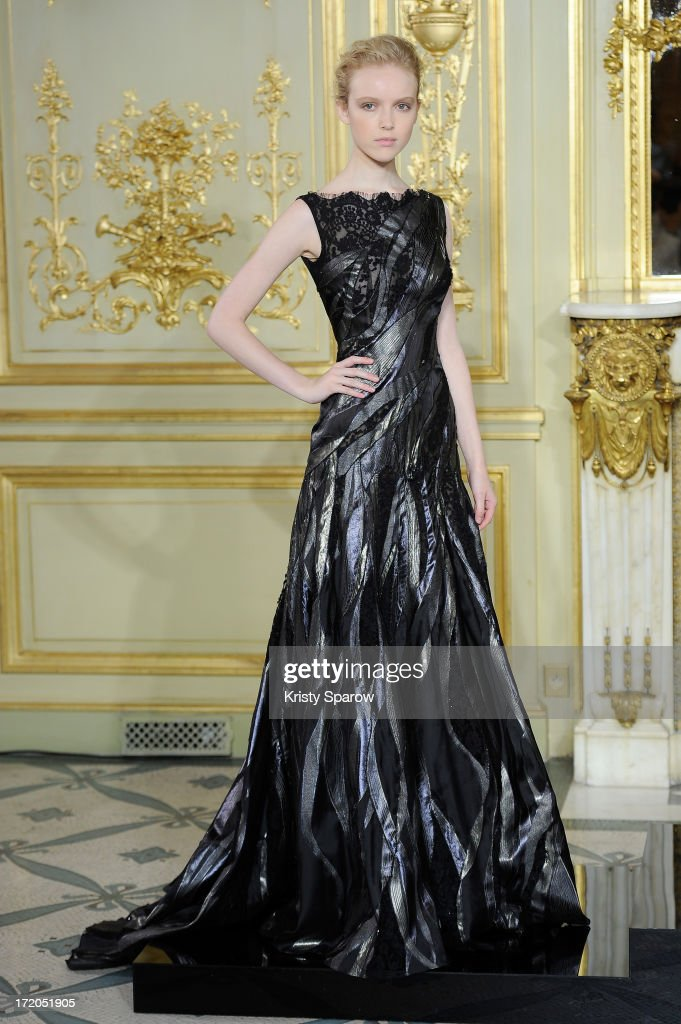 A model poses on the runway during Rami Al Ali show as part of Paris Fashion Week Haute-Couture Fall/Winter 2013-2014 at on July 1, 2013 in Paris, France.
