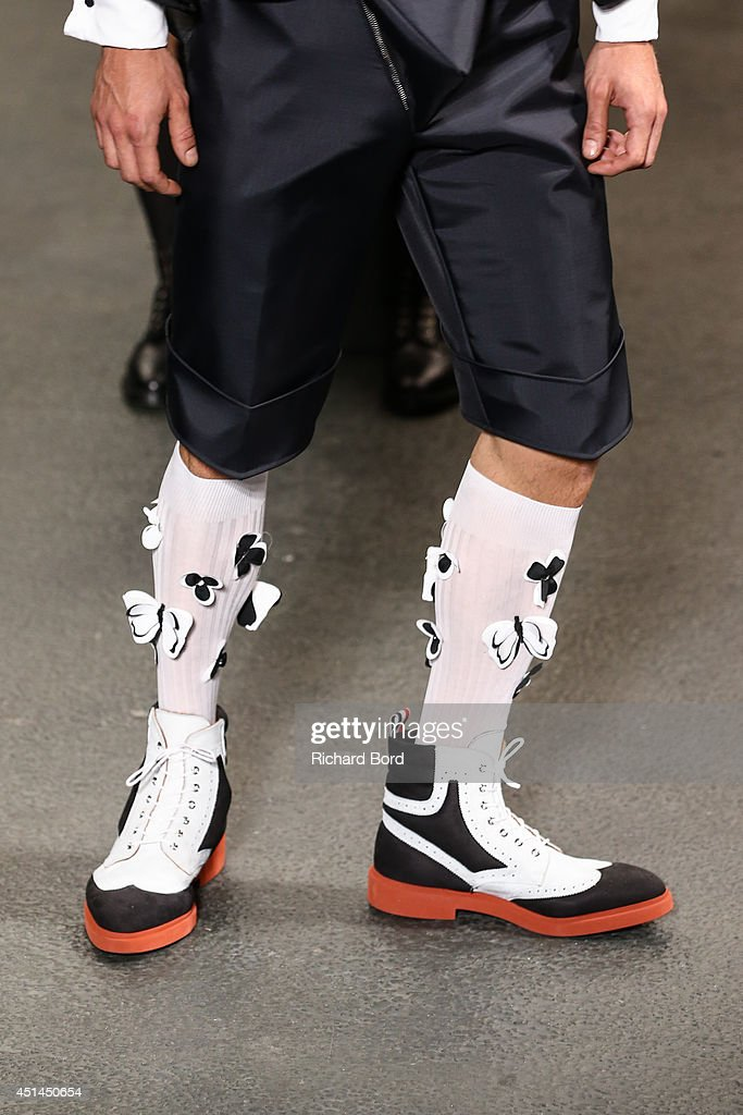 A model poses on the runway during the Thom Browne show as part of the Paris Fashion Week Menswear Spring/Summer 2015 at Halle Freyssinet on June 29, 2014 in Paris, France.