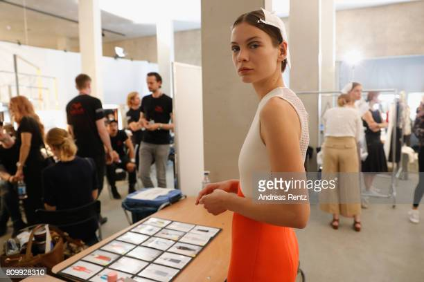 A model poses prior to the Hugo Boss presentation during 'Der Berliner Mode Salon' Spring/Summer 2018 at St Agnes Church on July 6 2017 in Berlin...