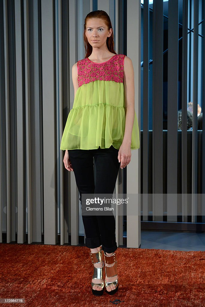 A model poses the runway at Simone Anes & Stephan Pelger Show during Mercedes-Benz Fashion Week Spring/Summer 2014 on July 3, 2013 in Berlin, Germany.