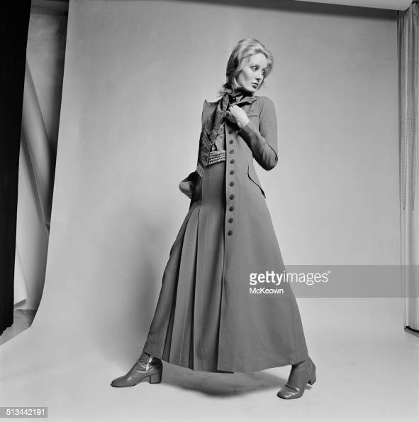 A model poses wearing a dark brown crêpe coat 1st August 1969