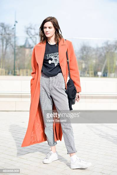 A model poses wearing a Thrasher tshirt on Day 9 of Paris Fashion Week Womenswear FW15 on March 11 2015 in Paris France