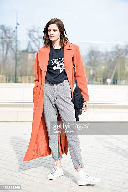 A model poses wearing a Thrasher tshirt on Day 9 of Paris Fashion Week Womenswear FW15 on March 11 2015 in Paris France