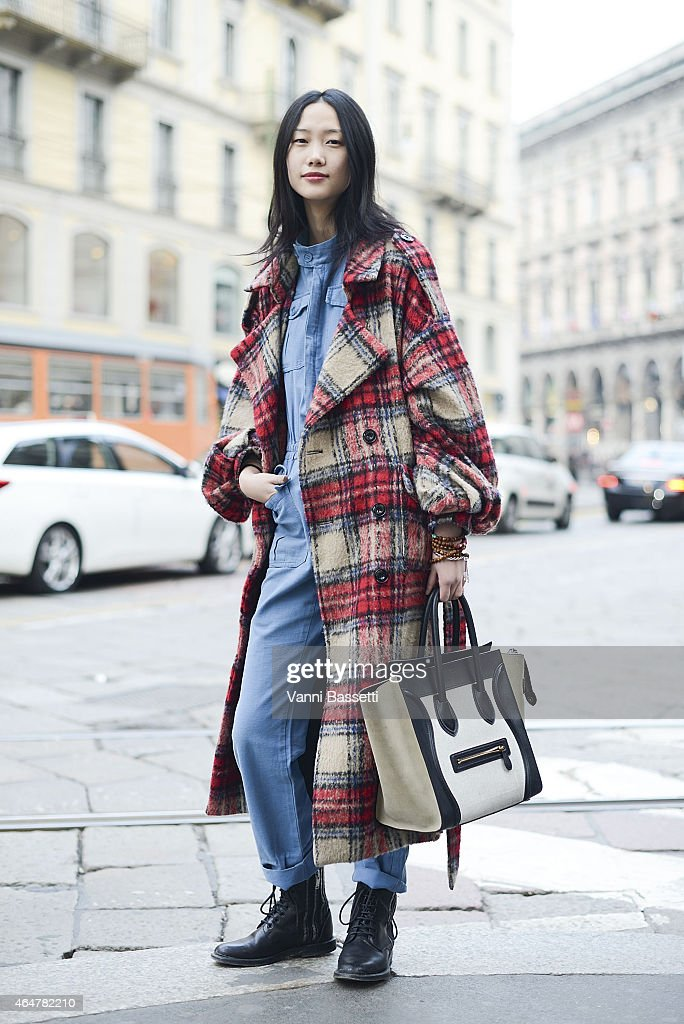 A model poses wearing a vintage coat and Celine bag on February 28 2015 in Milan Italy