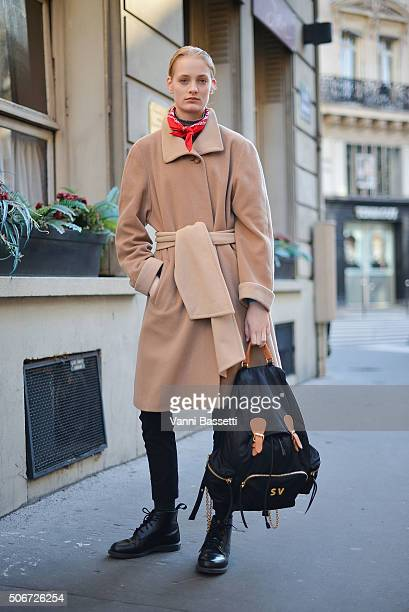 A model poses wearing a vintage coat Dr Martens shoes and Burberry backpack after the Schiaparelli show at Place Vendome during Haute Couture on...