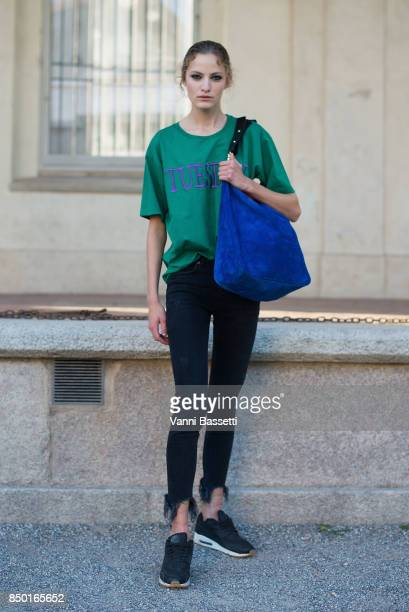 A model poses wearing an Alberta Ferretti jumper after the Alberta Ferretti show during Milan Fashion Week Spring/Summer 2018 on September 20 2017 in...