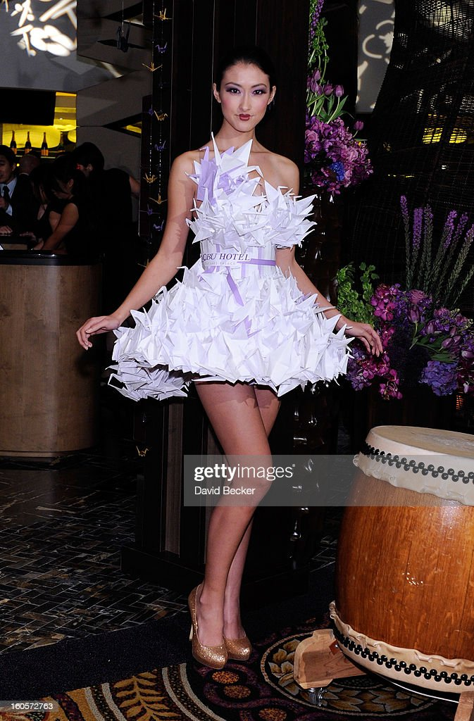 A model poses wearing an origami-style dress during a preview for the Nobu Restaurant and Lounge Caesars Palace on February 2, 2013 in Las Vegas, Nevada. The Nobu Hotel Restaurant and Lounge Casears Palace is scheduled to open on February 4.