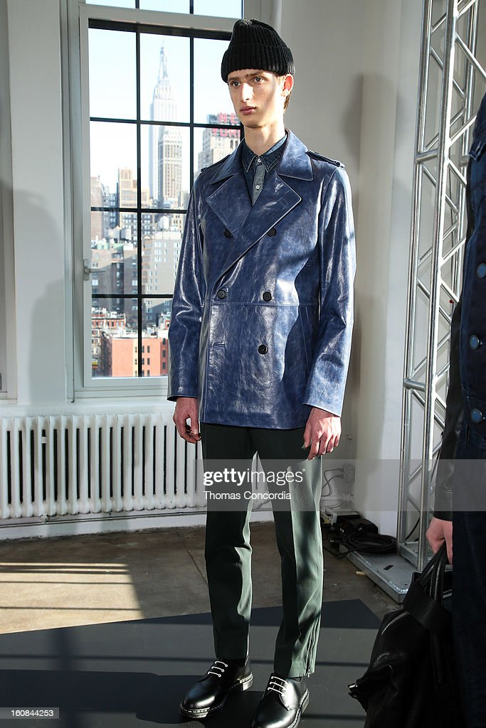 A model poses wearing DKNY MEN at the DKNY Mens Presentation during Fall 2013 Mercedes-Benz Fashion Week on February 6, 2013 in New York City.