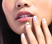 A model poses wearing JINsoon Nail Lacquer during JINsoon For Tibi Spring/Summer 2014 at Pier 59 on September 7 2013 in New York City