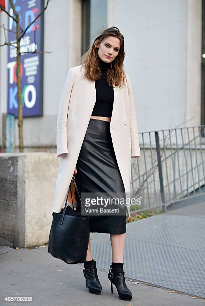A model poses wearing Karl Lagerfeld coat Zara skirt and St Laurent shoes on Day 7 of Paris Fashion Week Womenswear FW15 on March 9 2015 in Paris...
