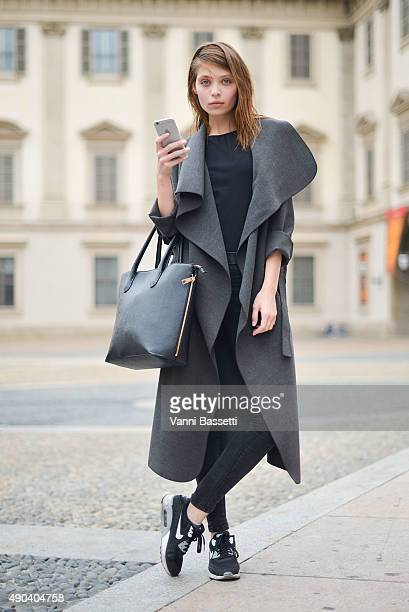 A model poses wearing Nike shoes after the Arthur Arbesser show during the Milan Fashion Week Spring/Summer 16 on September 28 2015 in Milan Italy