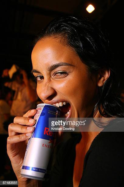 A model poses with a can of Red Bull backstage before the Zambesi Collection show at the Overseas Passenger Terminal during Mercedes Australian...