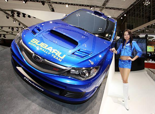 A Model Poses With Fuji Heavy Industries Ltds Subaru Wrc