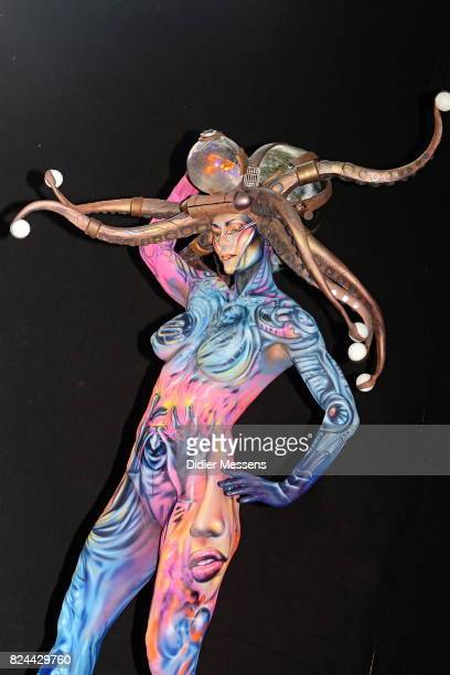 A model poses with her bodypainting designed by bodypainting artist Alex Hansen from Brazil during the 20th World Bodypainting Festival 2017 on July...