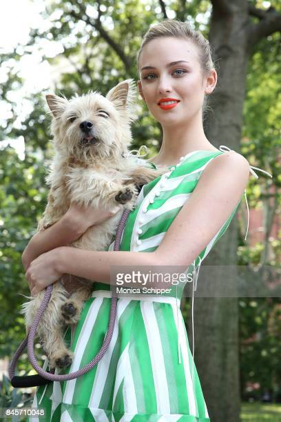 A model poses with Lela Rose's dog Bobbin for the Lela Rose Presentation during New York Fashion Week at Washington Square Park on September 11 2017...