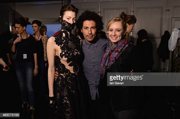 A model poses with makeup artist Boris Entrup and designer Irene Luft backstage ahead of the Irene Luft show during MercedesBenz Fashion Week...