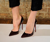 A model poses with shoes detail for the Katie Ermilio Presentation on February 11 2015 in New York City