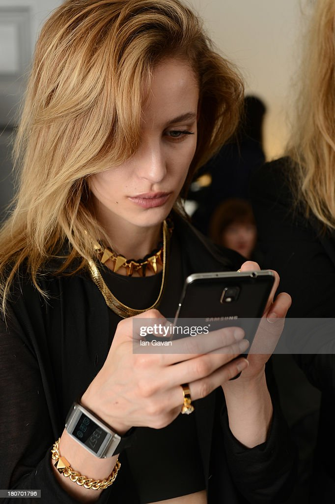 A model poses with the Samsung Galaxy Gear at London Fashion Week SS14 at BFC Courtyard Showspace on September 14 2013 in London England