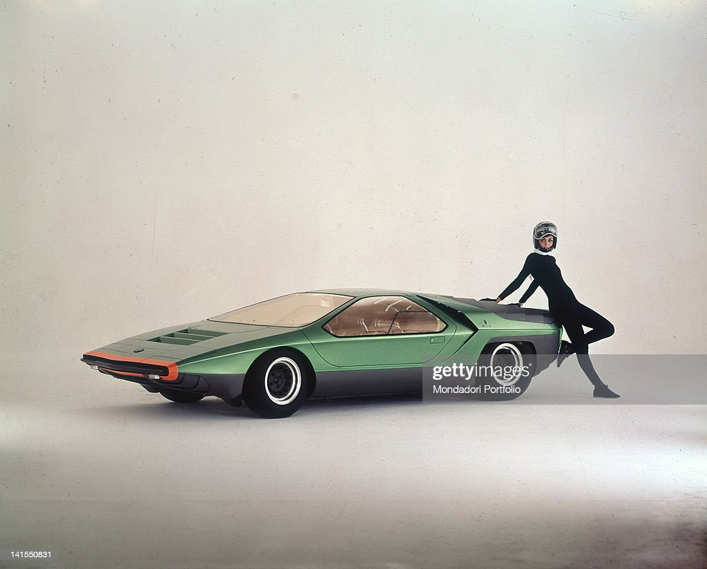 A model posing beside a Carabo car designed by Bertone and mounted on the chassis of Alfa Romeo P33 1960s