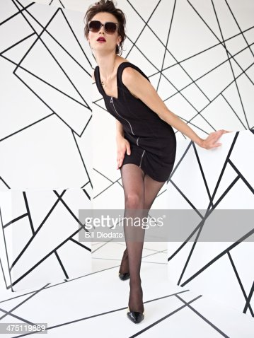 Model posing in black dress in studio