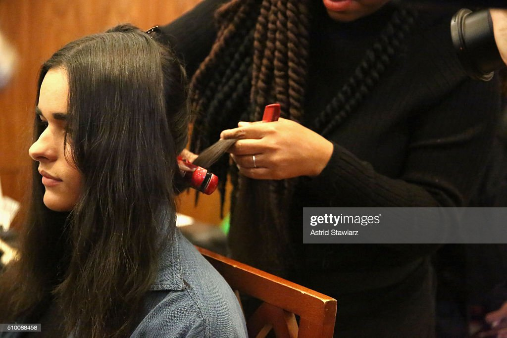 A model prepares at TRESemme at Mara Hoffman A/W16 Presentation at High Line Hotel, The Refectory on February 13, 2016 in New York City.