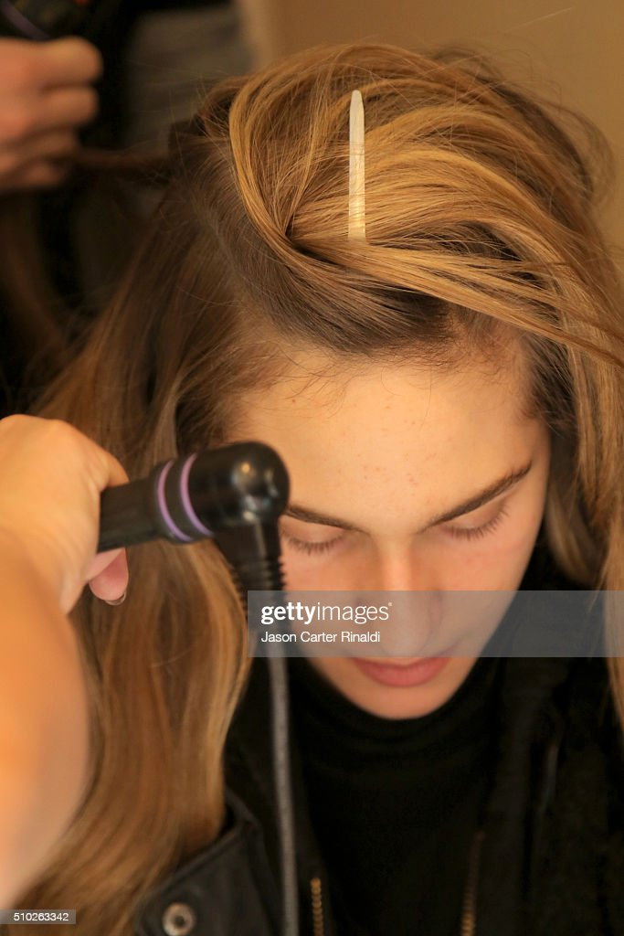 A model prepares back stage at SheaMoisture at Tracy Reese F/W 2016 NYFW at Roxy Hotel on February 14, 2016 in New York City.