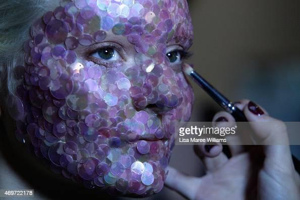 A model prepares backstage ahead of the Akira show at MercedesBenz Fashion Week Australia 2015 at Carriageworks on April 15 2015 in Sydney Australia