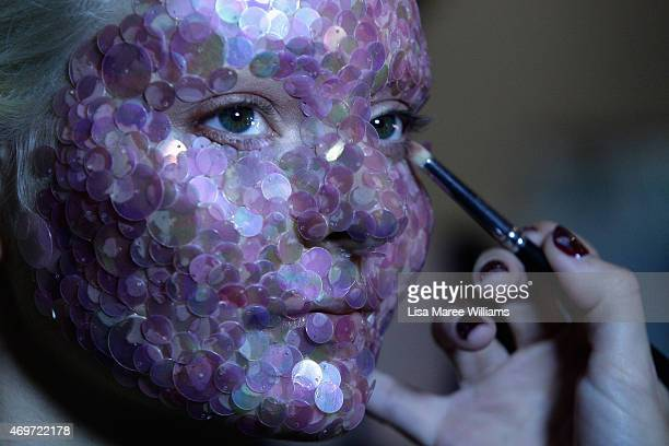 A model prepares backstage ahead of the Akira show at MercedesBenz Fashion Week Australia 2015 at Carriageworks on April 15 2015 in Sydney Australia