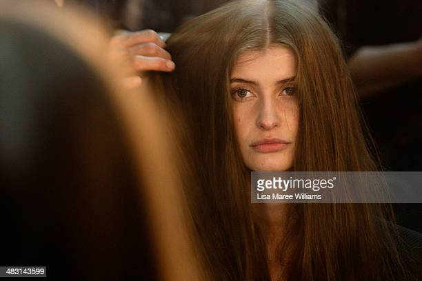 A model prepares backstage ahead of the Alex Perry show at MercedesBenz Fashion Week Australia 2014 at Carriageworks on April 7 2014 in Sydney...