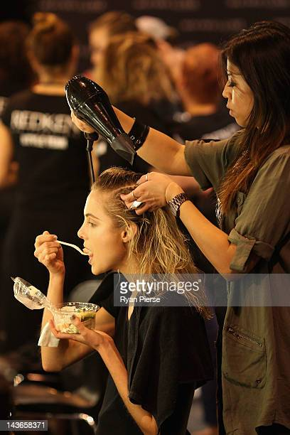 A model prepares backstage ahead of the An Ode To No One show on day three of MercedesBenz Fashion Week Australia Spring/Summer 2012/13 at Overseas...