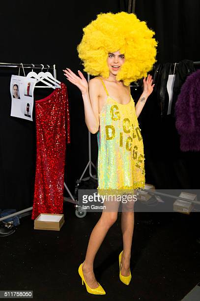 A model prepares backstage ahead of the Ashish show during London Fashion Week Autumn/Winter 2016/17 at Brewer Street Car Park on February 22 2016 in...