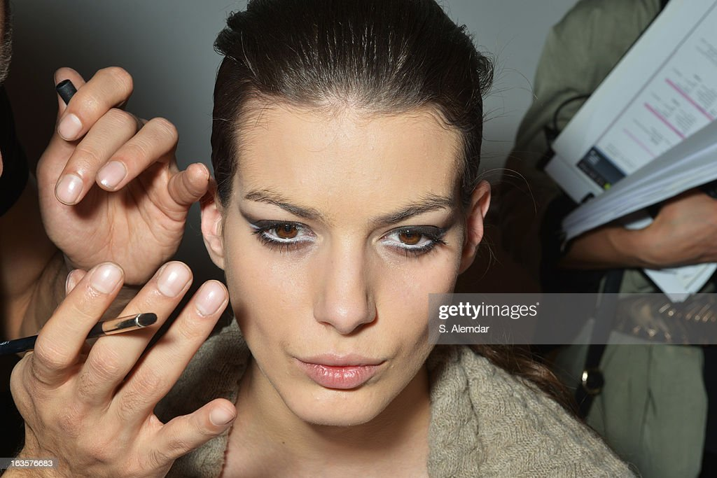 A model prepares backstage ahead of the Atilkutoglu show during Mercedes-Benz Fashion Week Istanbul Fall/Winter 2013/14 at Antrepo 3 on March 12, 2013 in Istanbul, Turkey.
