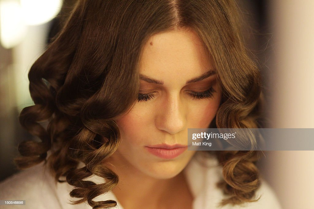 A model prepares backstage ahead of the Bendon show as part of the MercedesBenz Fashion festival Sydney 2012 at Sydney Town Hall on August 21 2012 in...